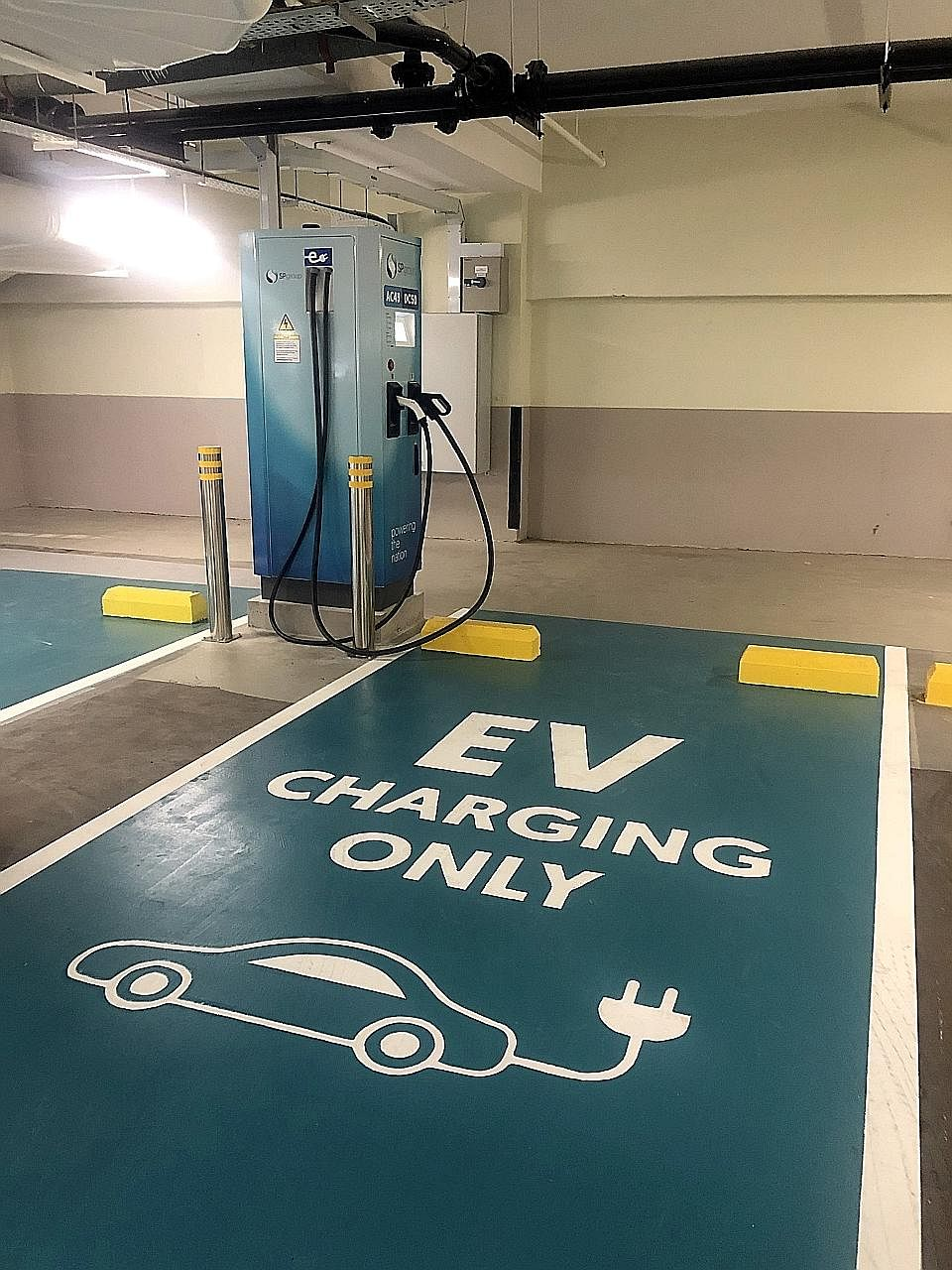 City Developments' (CDL) electric vehicle charging station at Republic Plaza. Carbon footprint reduction is one of CDL's top priorities.
