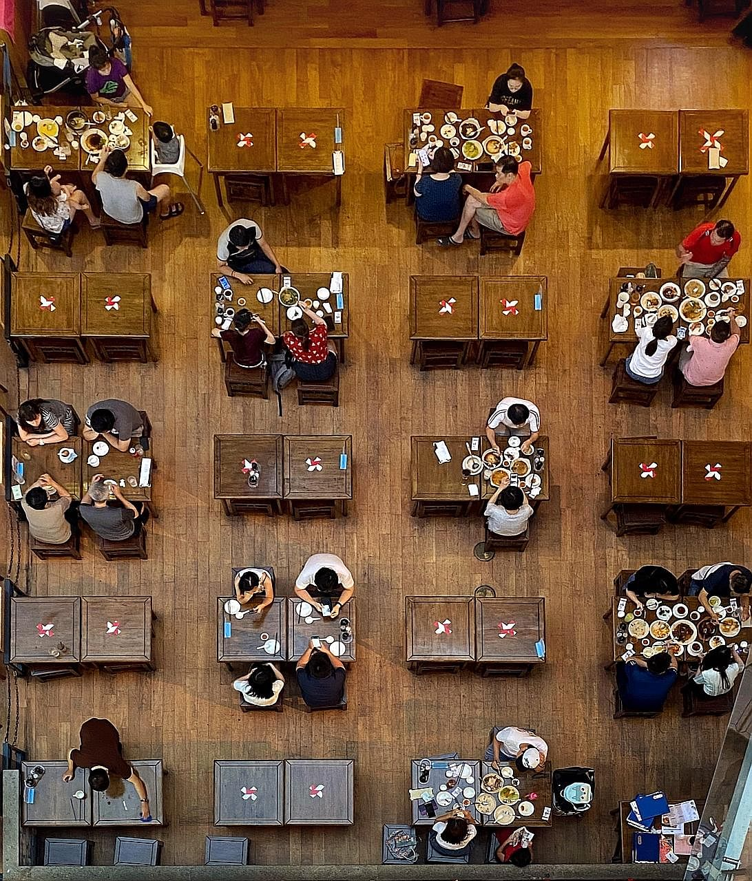 Social distancing measures taken at Dian Xiao Er in Jurong Point, in March. The restaurant chain has taken out a $2 million loan under the Temporary Bridging Loan Programme to be used for working capital and tech upgrading.