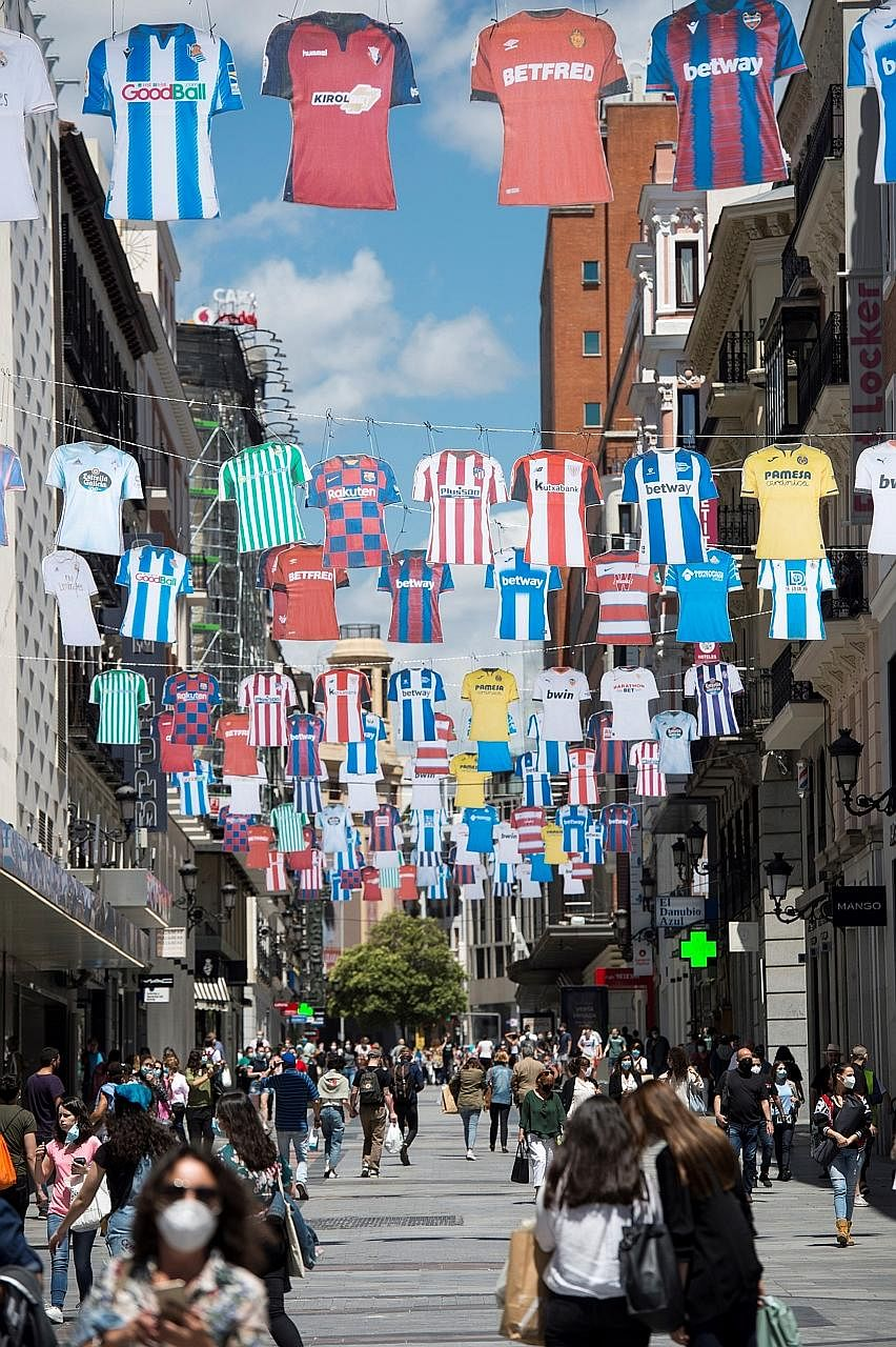 Diego Forlan believes that team managers must empathise with players who are concerned about the risks of catching Covid-19 when they return to action. Football jerseys decorate a shopping street in downtown Madrid on Monday. The Spanish La Liga resu