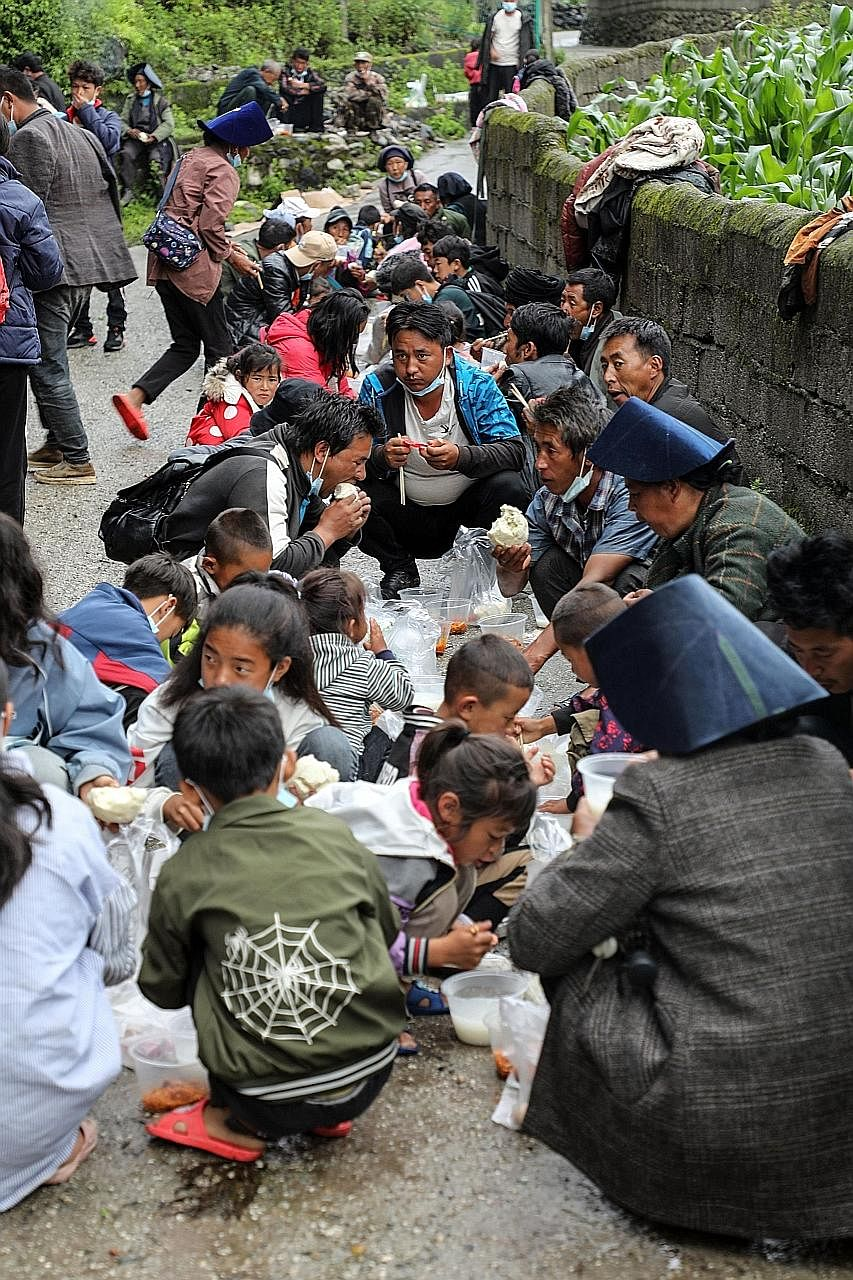 People affected by floods having breakfast at a temporary shelter in Mianning county, in the Liangshan Yi Autonomous Prefecture of south-western Sichuan province yesterday. Much of the damage has hit south-western regions of China such as Guangxi and