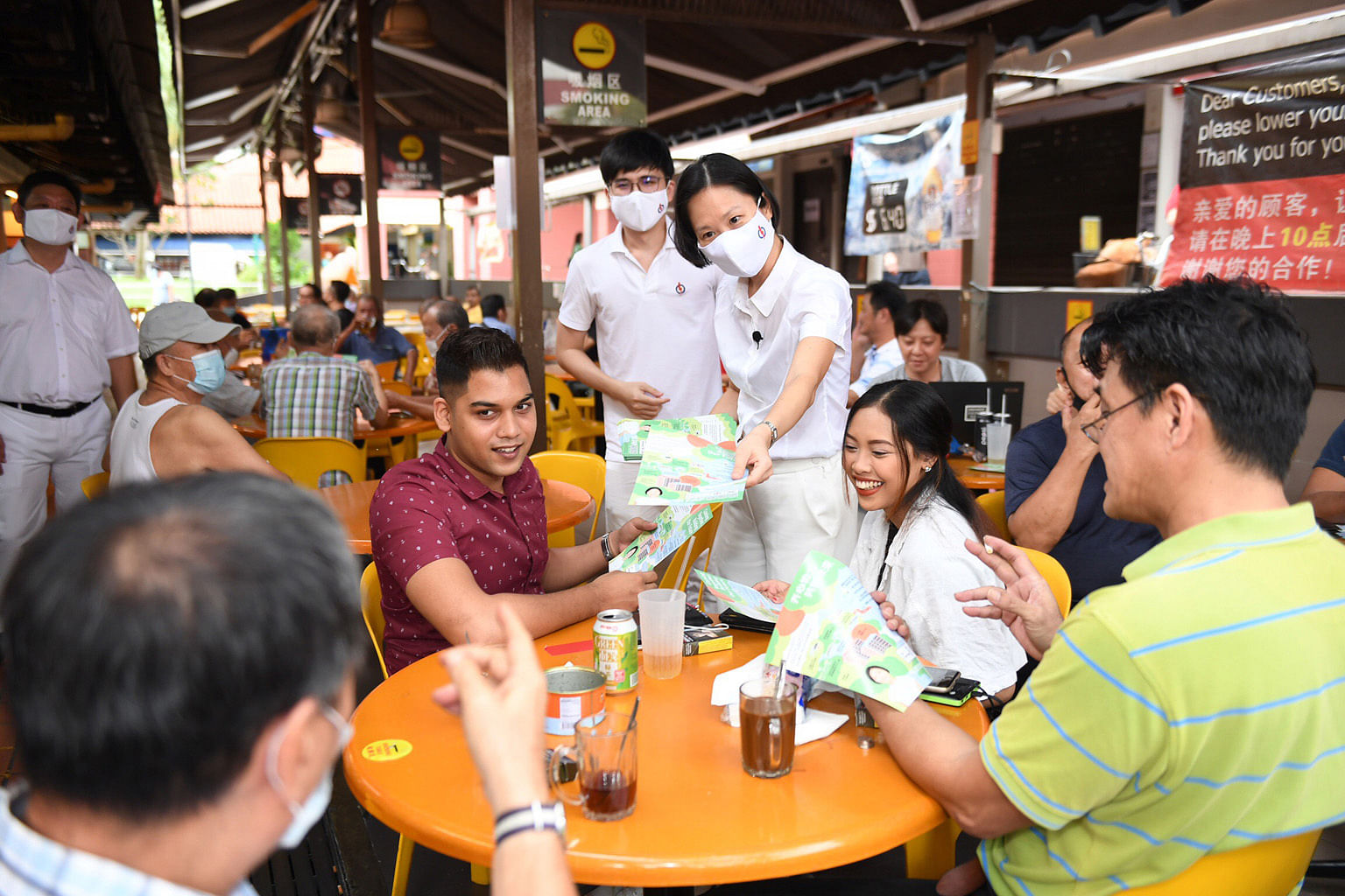 Ms Gan Siow Huang reaching out to residents at a coffee shop in Bishan Street 24 last week. She has been touted as among those slated for higher political office, if elected.