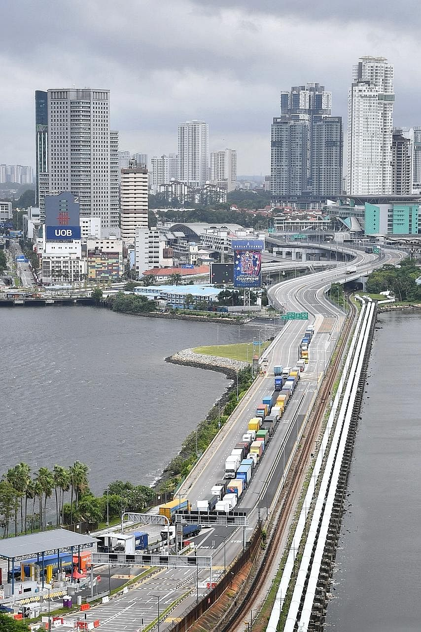 The Causeway linking Singapore and Malaysia in April. The two countries' green lane arrangement offers an important test case of how countries can successfully lift curbs while keeping Covid-19 in check, say the writers.