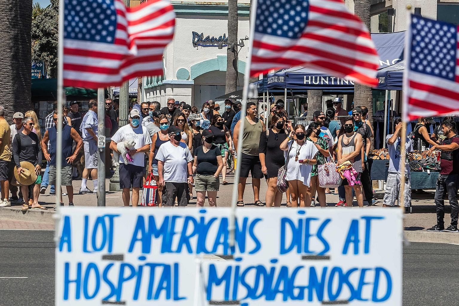 A sign protesting against the healthcare system, in Huntington Beach, California, on Sunday. After the US government committed US$3 trillion (S$4.2 trillion) to support the economy through curbs in April and May, the virus is surging to record levels