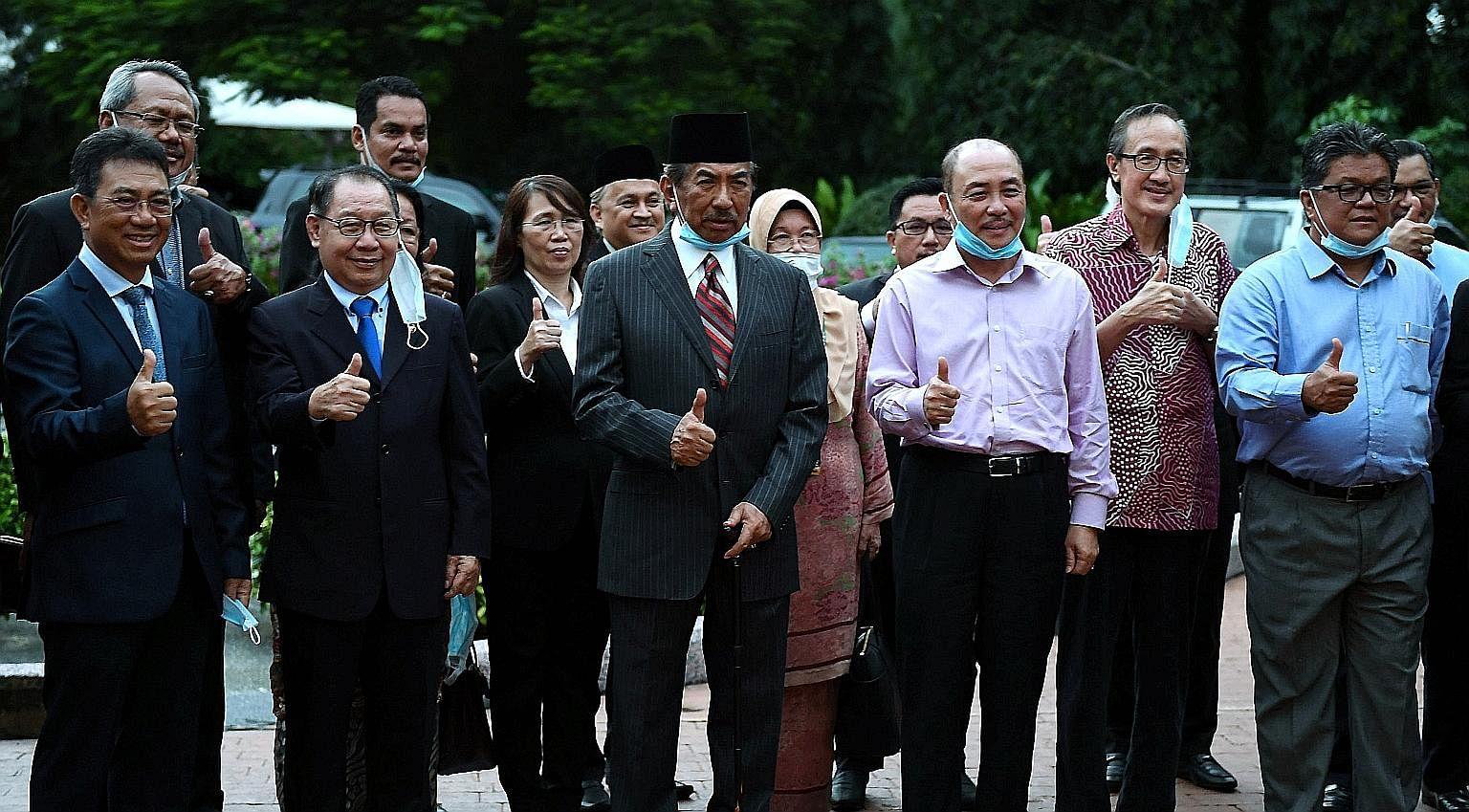 Former Sabah chief minister Musa Aman (centre) with other state assemblymen on the grounds of his house after a media conference on Wednesday. The state polls will represent the first major political battle between the five-month-old Perikatan Nasion
