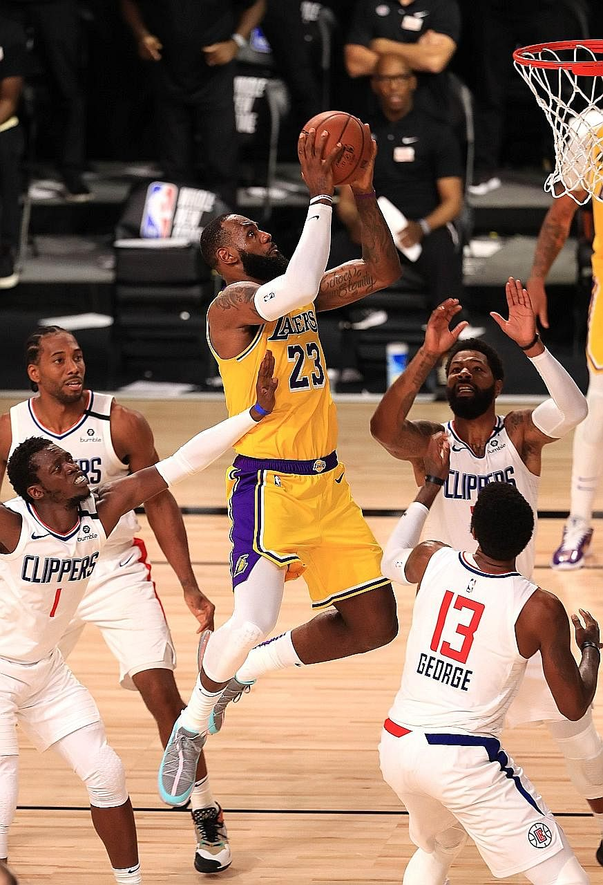 LeBron James going for a basket against the LA Clippers on Thursday. He netted the winning shot with 12.8sec left in the the Lakers' 103-101 NBA victory and they need one win to seal the top seeding in the West.