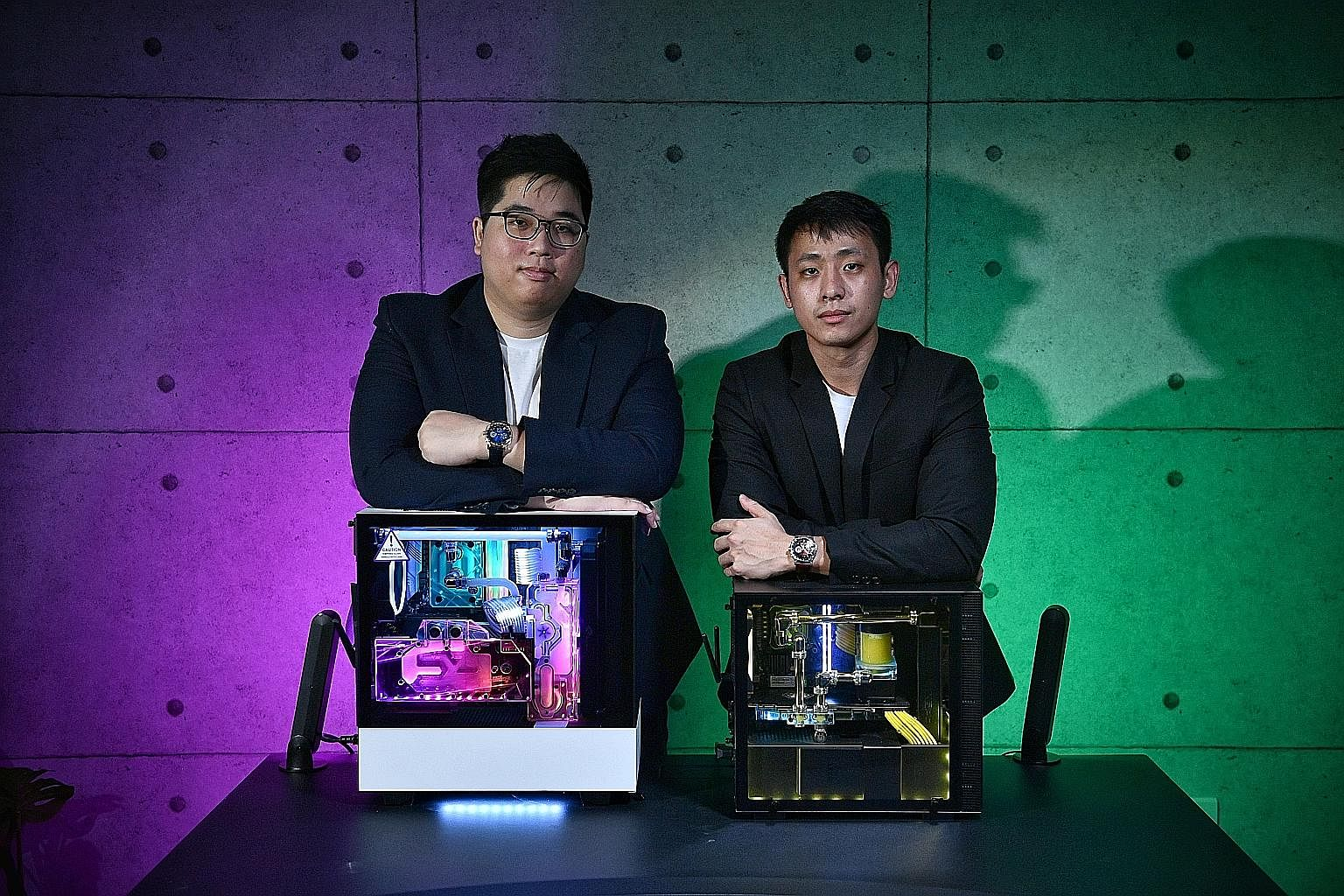 Marcus (right) and Joe (second from left, back) at one of their first IT shows. Aftershock gaming laptops have won a slew of awards from publications and websites, including The Straits Times and Hardware Zone. Fraternal twins Marcus (left) and Joe W