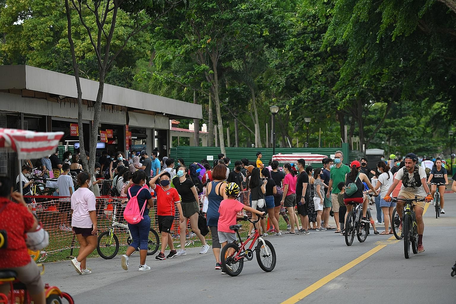 The lunch-time crowd in Bugis Street on Tuesday. More travellers are expected as Singapore gradually reopens its borders. The bustle near a bicycle rental shop in East Coast Park last Friday. Covid-19 task force co-chair Lawrence Wong said Singapore