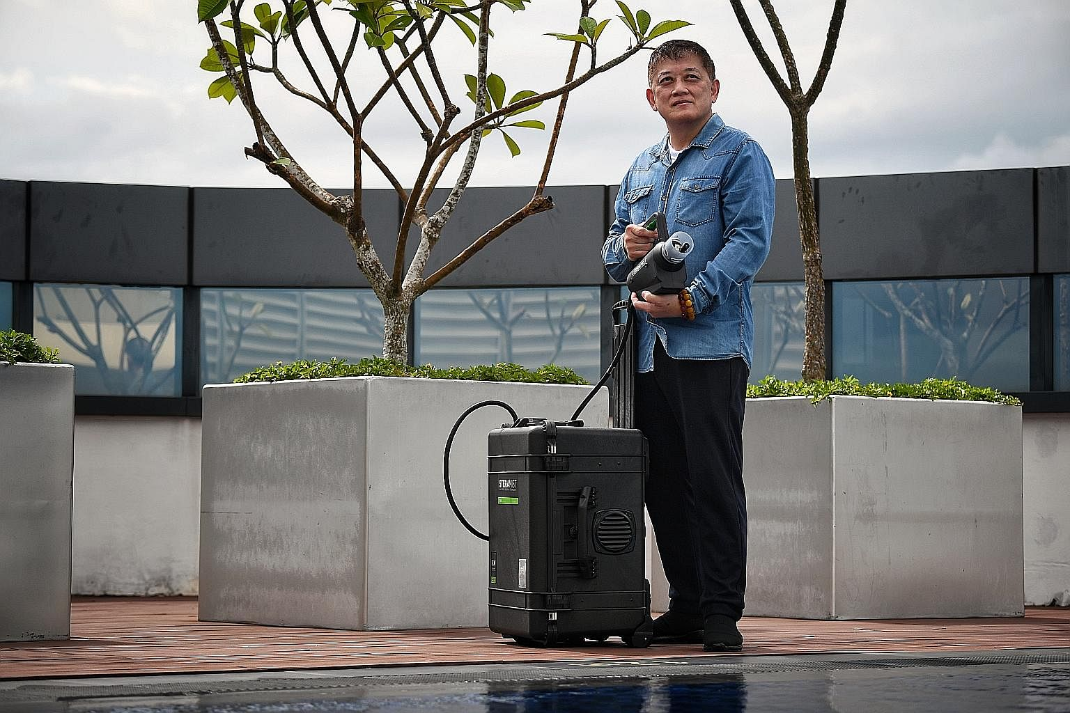 With his Oman projects halted, Mr Nicholas Koh has ventured into new businesses, including marketing the Tomi SteraMist, a decontamination solution from the United States. Ms Reene Ho-Phang and her husband Peter Phang (both above) - who run travel ma