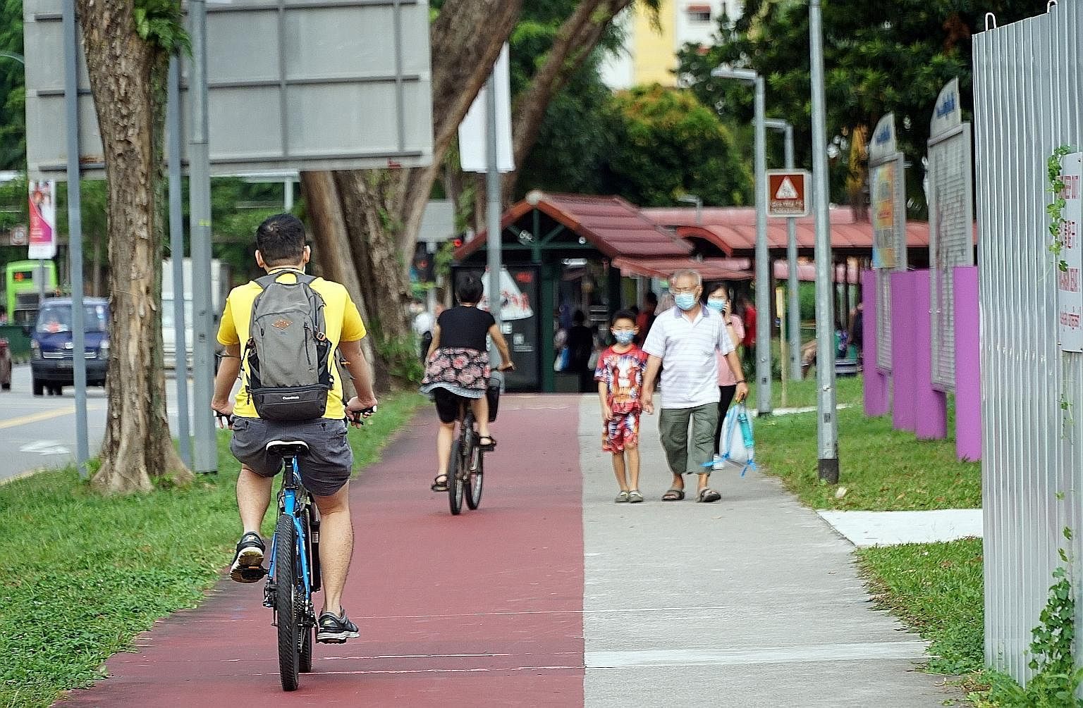 """Cyclists in Ang Mo Kio earlier this month. Transport Minister Ong Ye Kung said yesterday the reduced traffic and new travel patterns created by Covid-19 have opened a """"window of opportunity to reimagine"""" the road infrastructure, and certain underused"""