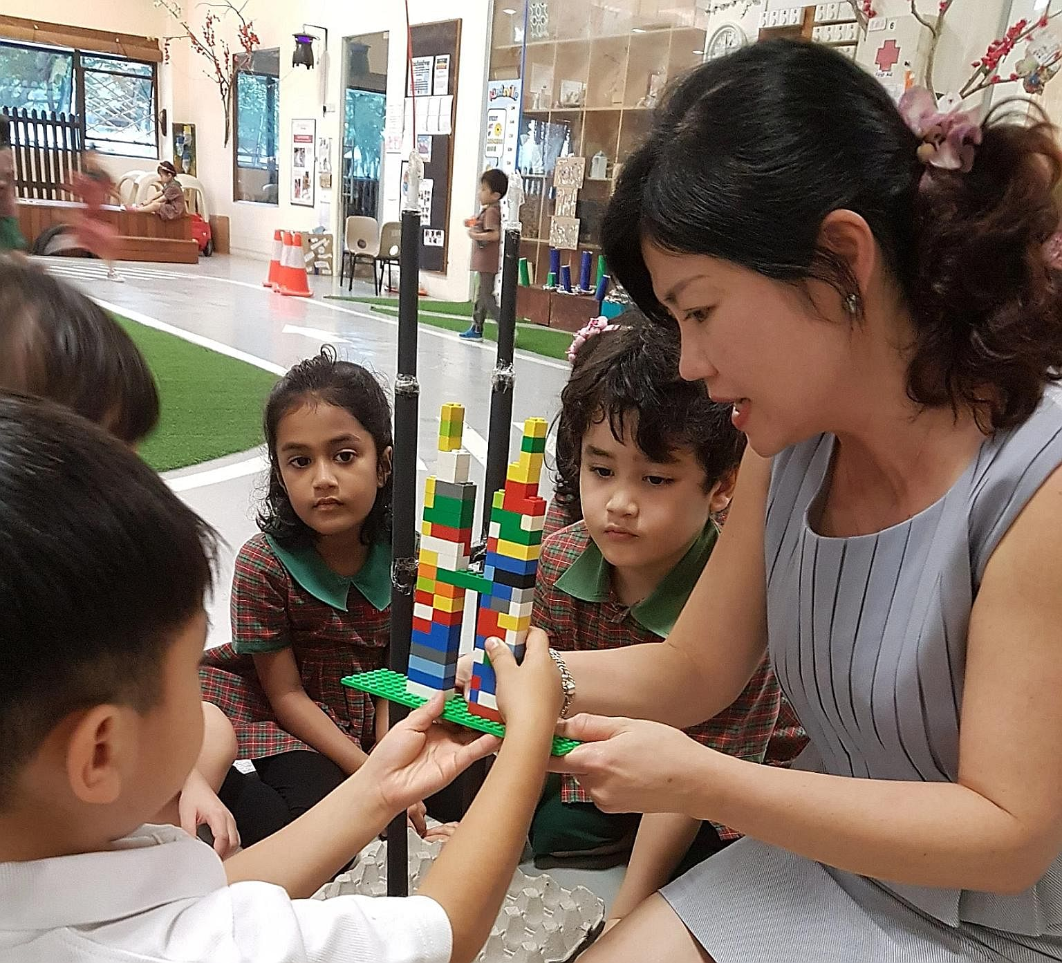 EtonHouse Pre-School Mountbatten 223 senior principal Josephyne Ho, 50, interacting with pupils. She joined the international school group in 2003 after a decade with SIA Group.