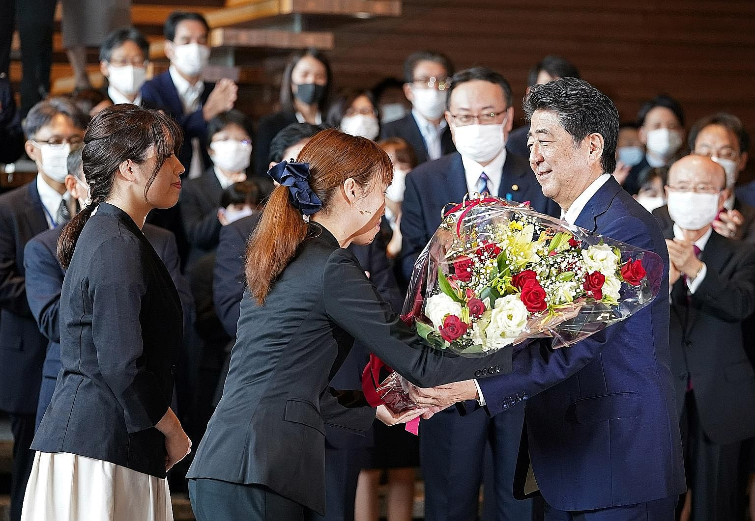 Mr Shinzo Abe, Japan's longest-serving leader with 3,188 days at the helm, called time on his tenure yesterday, receiving a bouquet and a poignant send-off upon his departure from the prime minister's official residence in Tokyo. Mr Yoshihide Suga (c