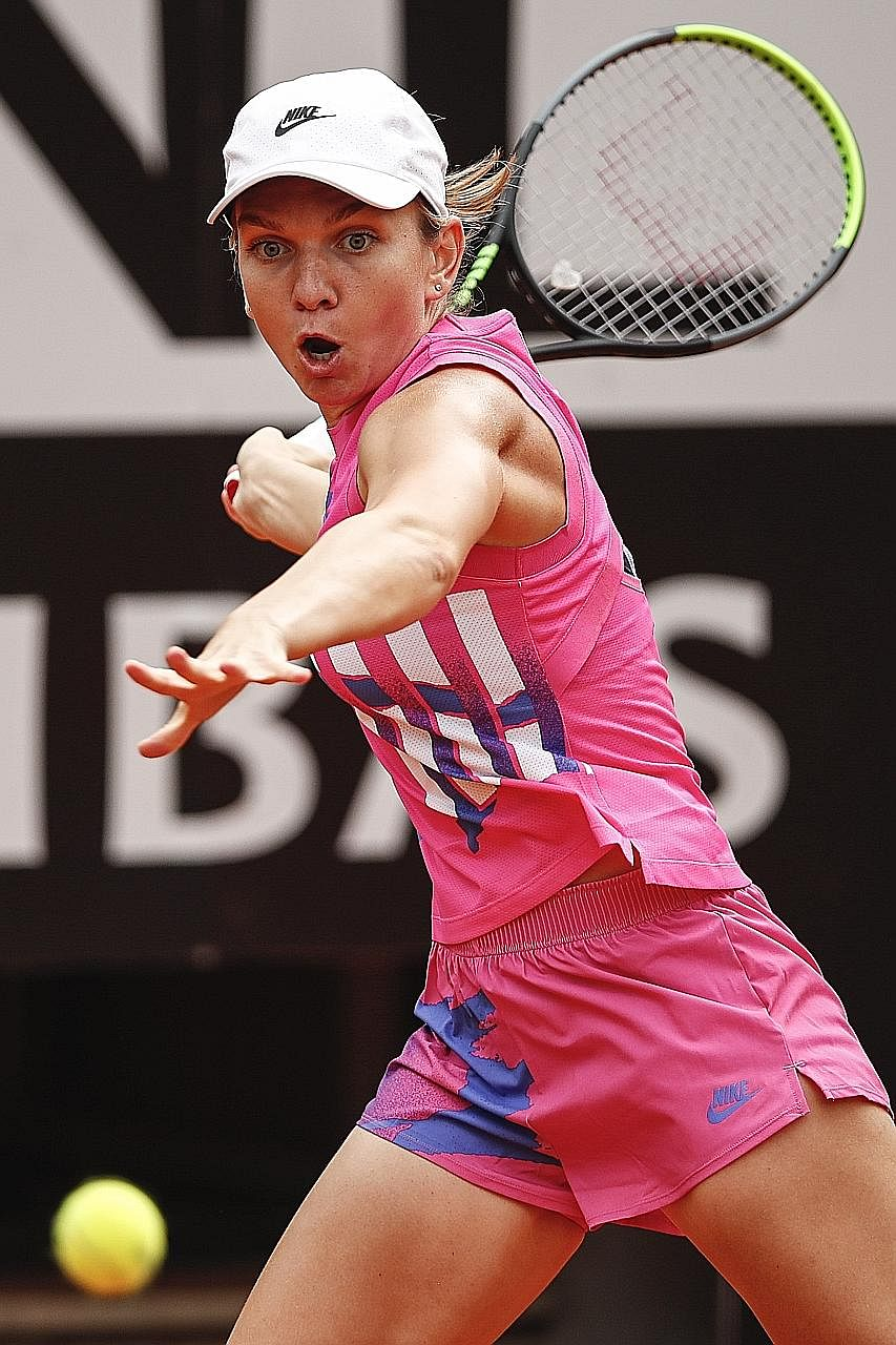 Simona Halep hitting a forehand against Karolina Pliskova in the Italian Open yesterday. The final lasted 31 minutes.