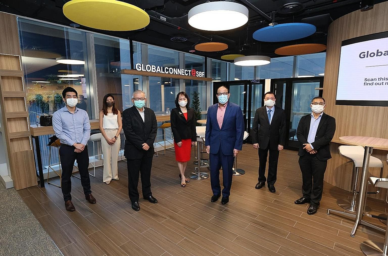 Minister for Communications and Information S. Iswaran (in blue suit) with Singapore Business Federation (SBF) office-bearers (from far left), Mr Collin Sim, assistant market development manager of Tee Yih Jia Food Manufacturing; Ms Priscilla Ng, mar