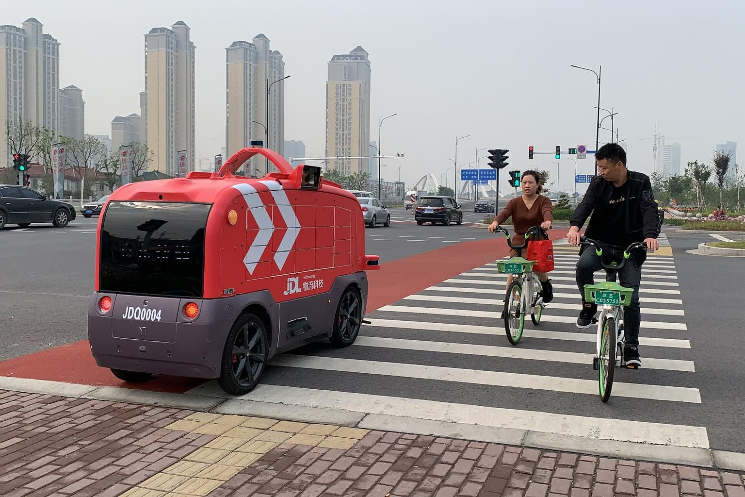 Autonomous delivery vehicles deployed in Chinese cities amid the Covid-19  pandemic, East Asia News & Top Stories - The Straits Times