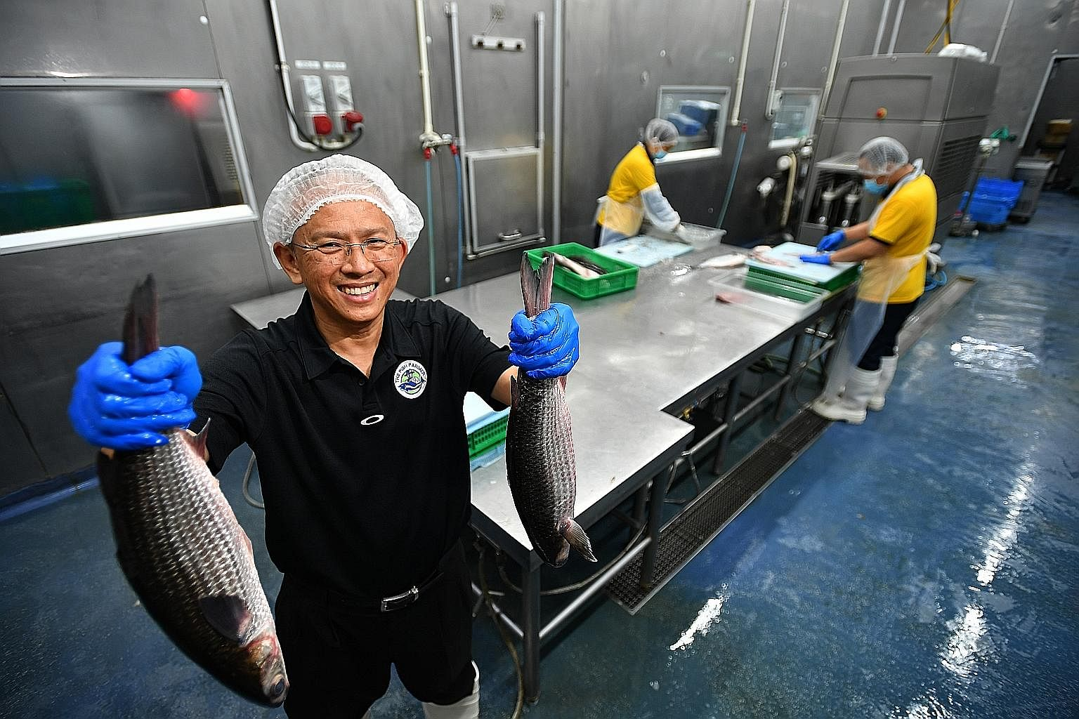 Staff making assam mullet chowder at The Soup Spoon's production kitchen. Fishery company The Fish Farmer sends the mullet it farms to Hai Sia Seafood, which scales the fish and processes it into fillets. Instead of the offcuts being discarded, they