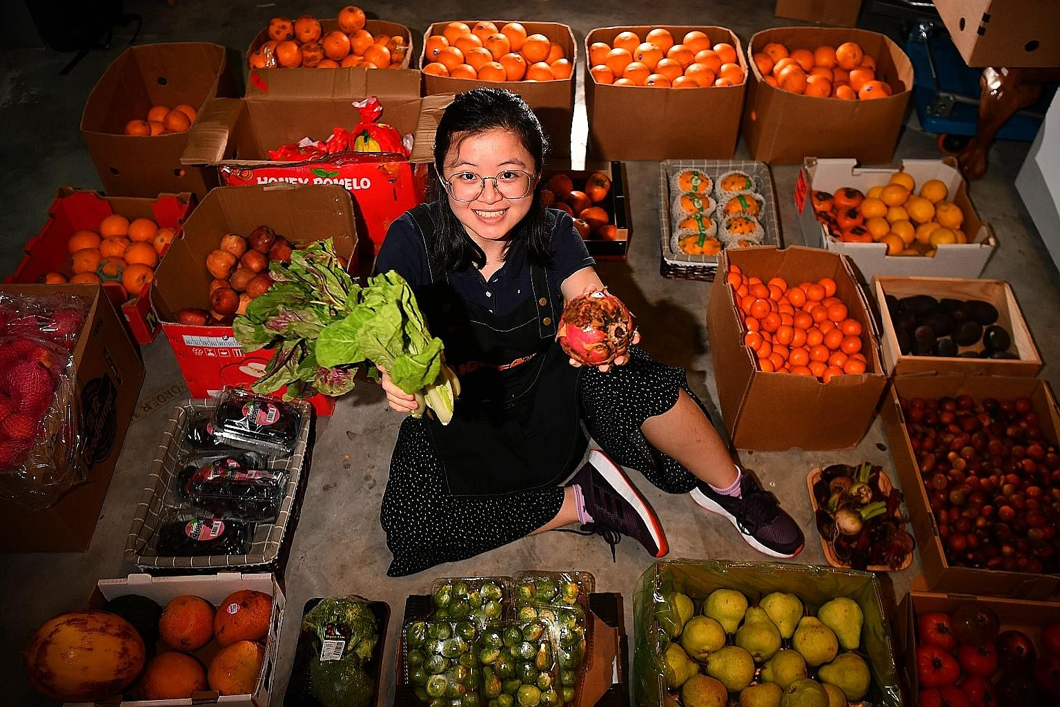 LIM YAOHUI Ms Yeo Pei Shan, co-founder of UglyFood, with the rejected blemished fruit an