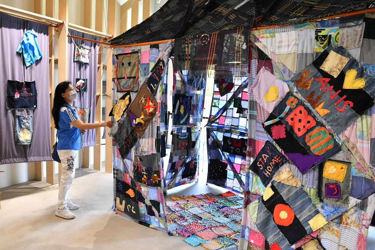 A visitor looking at the Stay Home Quilt at the Tzu Chi Humanistic Youth Centre on Dec 27, 2020. ST PHOTO: CHONG JUN LIANG