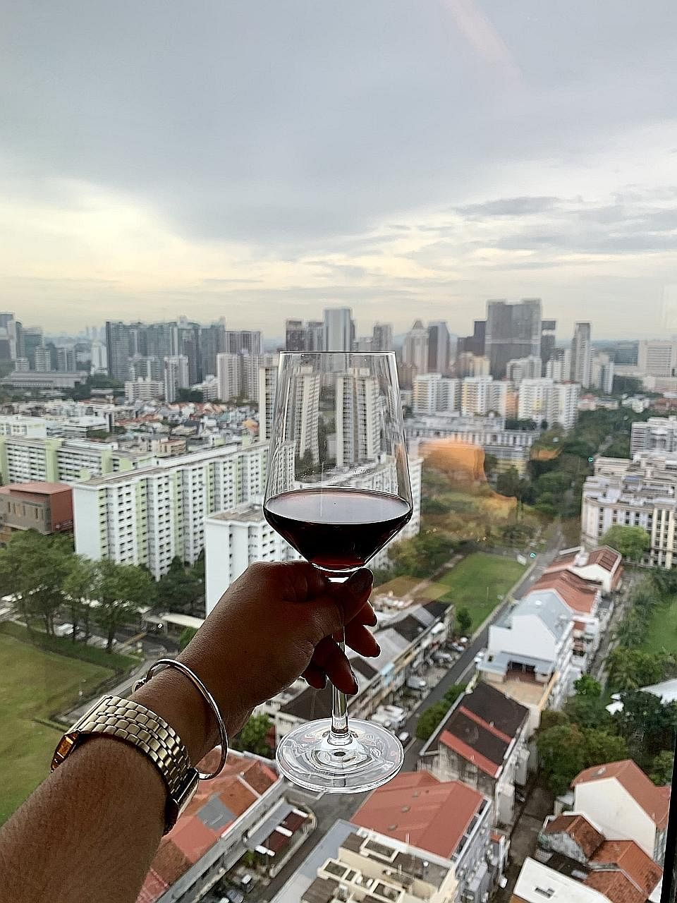 (Right) View of the bustling Farrer Park neighbourhood from Mint Hotel's 19th-floor room. A room in Mint Hotel at One Farrer Hotel.