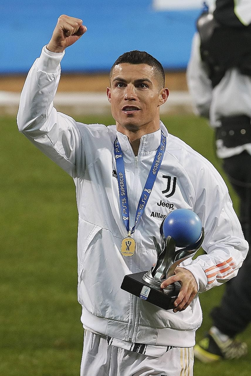 Cristiano Ronaldo celebrating after helping Juventus beat Napoli 2-0 to clinch the Italian Super Cup on Wednesday. It was the Portuguese forward's 30th trophy of his career.