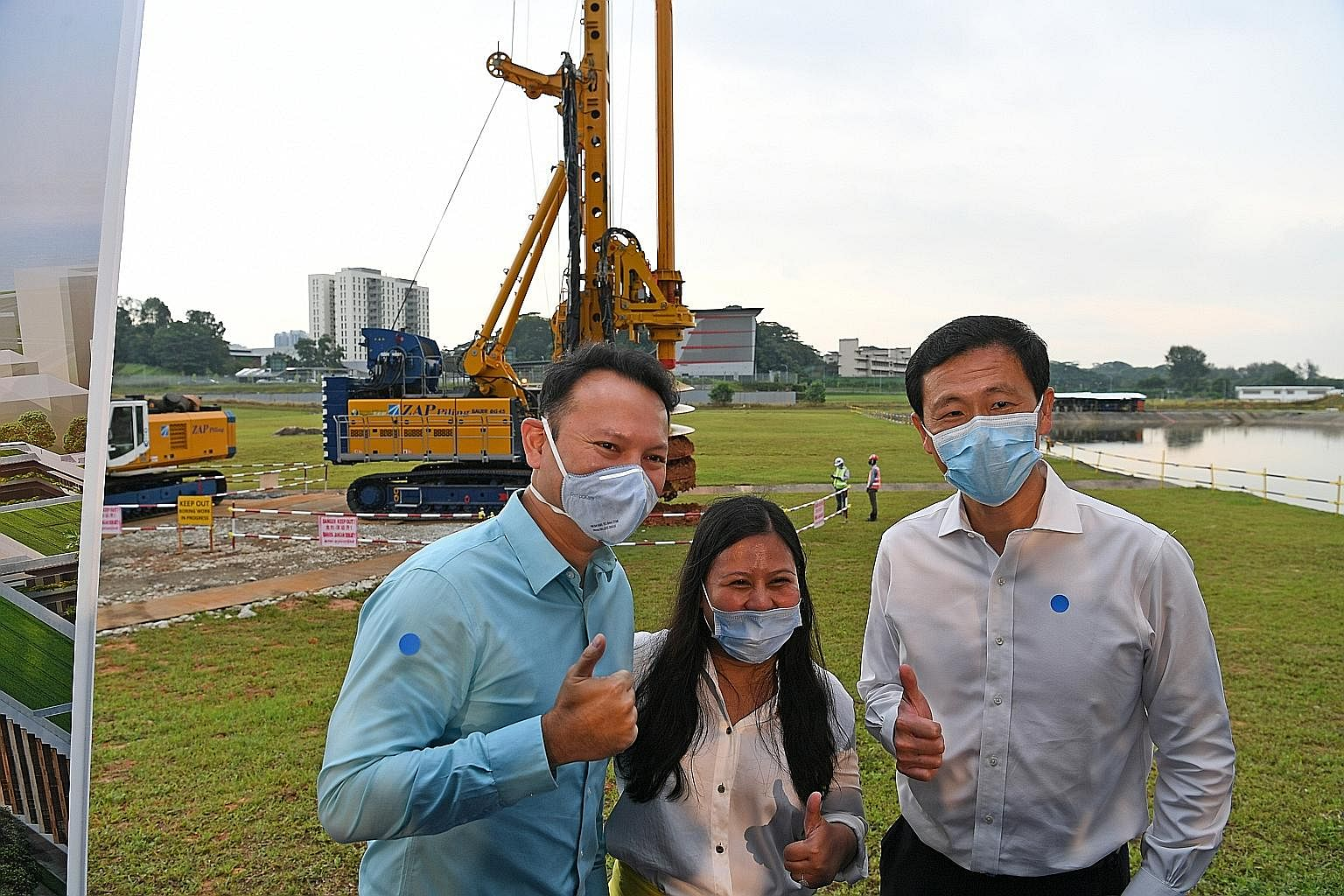 (From left) Senior Minister of State for Defence and Manpower Zaqy Mohamad, MP for Sembawang GRC Mariam Jaafar and Transport Minister Ong Ye Kung at the parcel of land that will be the site of the Woodlands North RTS station.