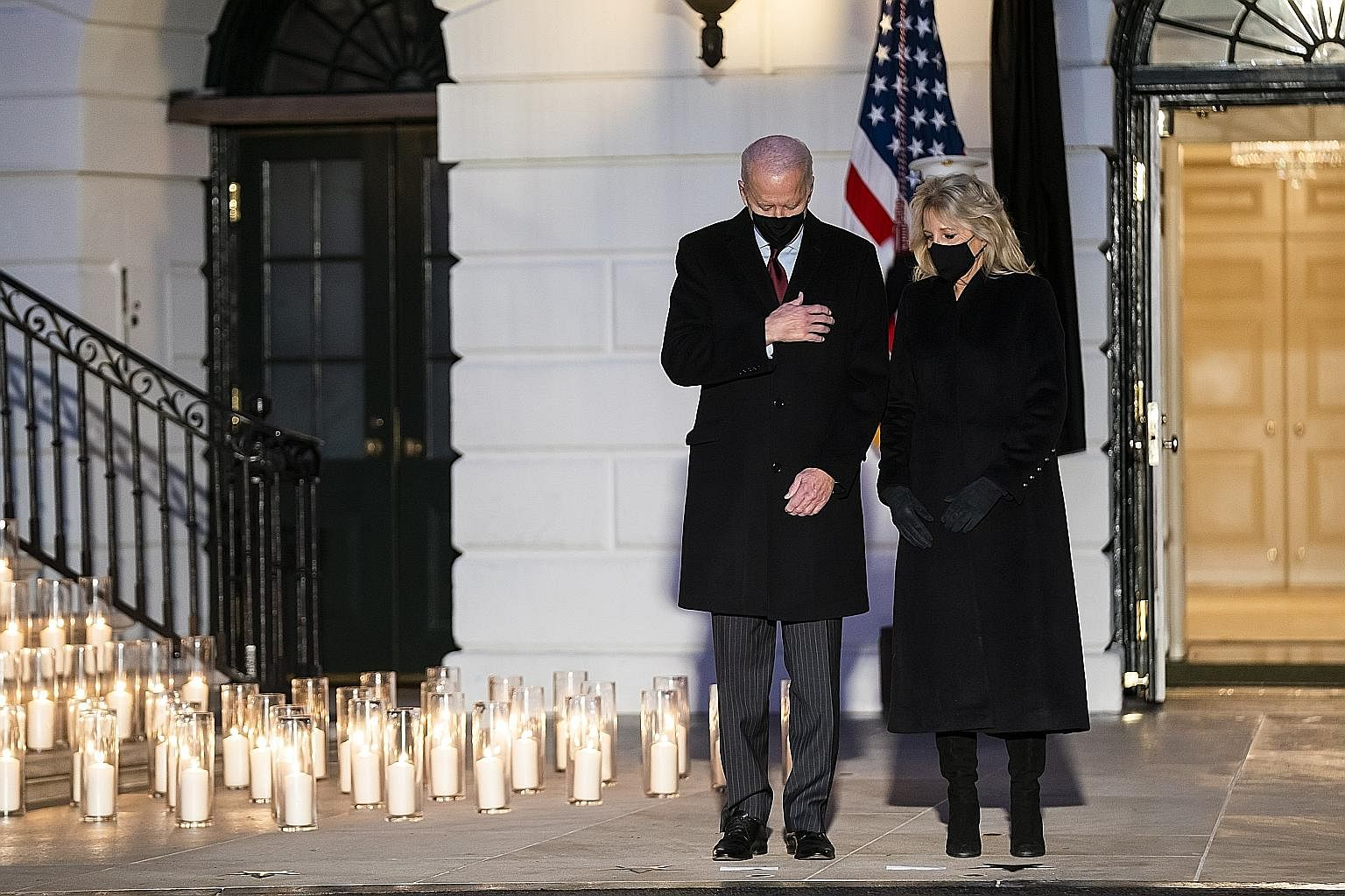US President Joe Biden and First Lady Jill Biden observing a moment of silence on Monday, at a White House ceremony to mourn the more than 500,000 lives lost to Covid-19 in the country.