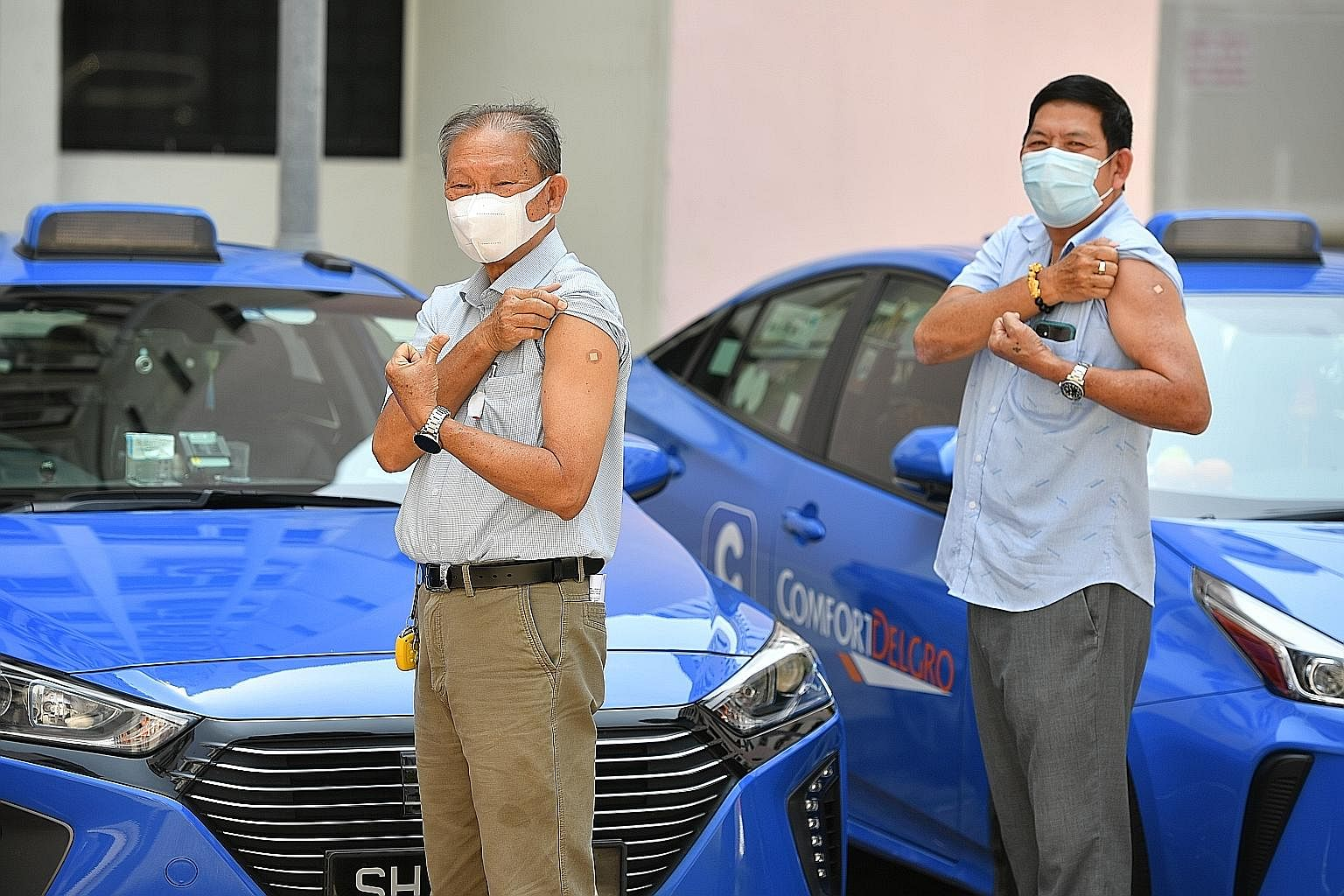 More than 50,000 active taxi and private-hire car drivers will be offered the chance to get their first dose of the Covid-19 vaccine by the end of this week. About 300 drivers, including cabbies Tham Yuet Kok (right) and Tan Eng Chuan (far right), ha