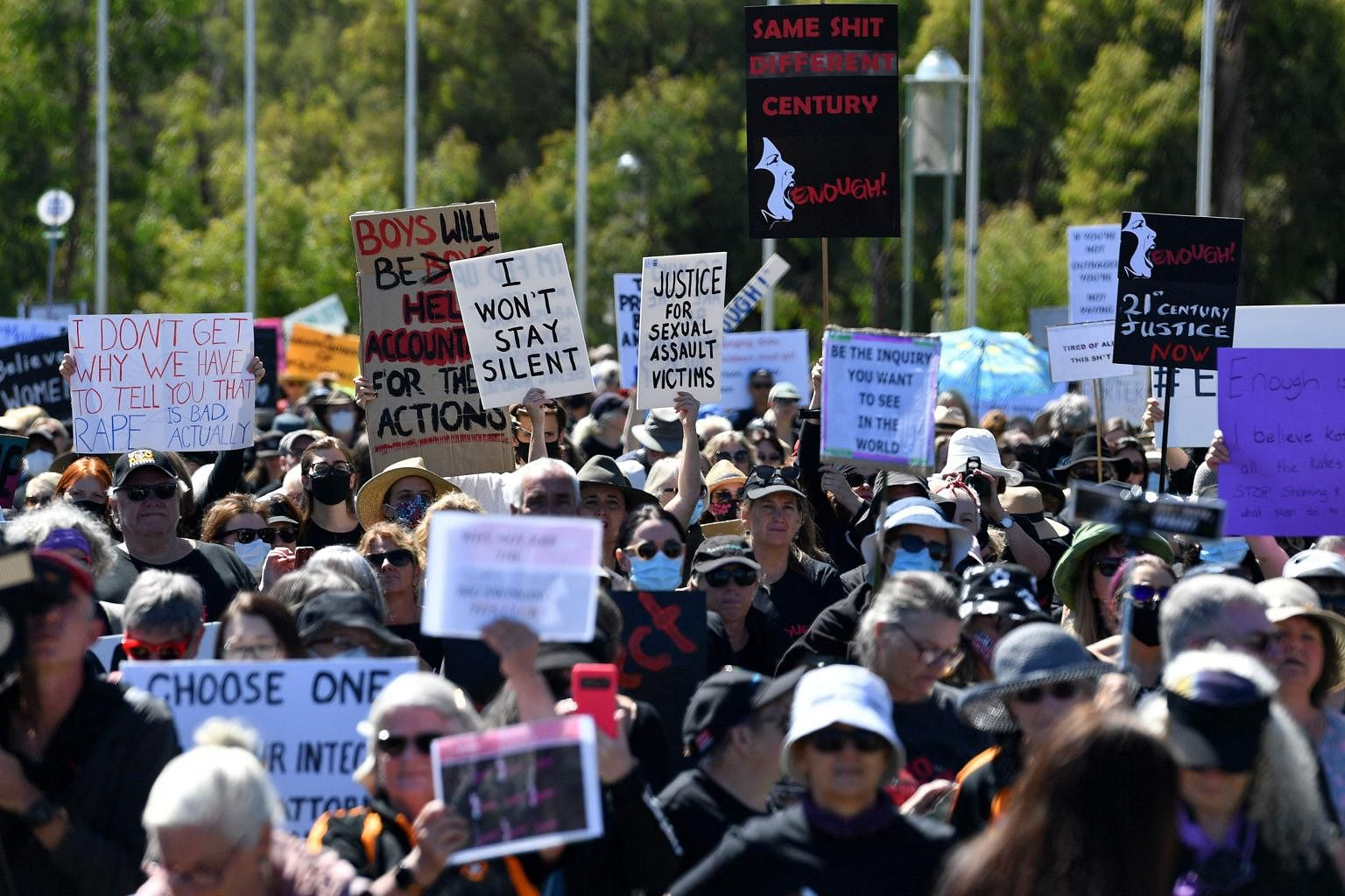 Protesters attend a rally against sexual violence and gender inequality in Canberra