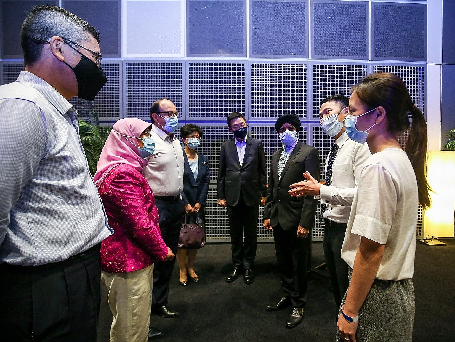 President Halimah Yacob and Minister for Communications and Information S. Iswaran yesterday at the Infocomm Media Development Authority's Partners' Appreciation event to recognise those who contributed to digital inclusion and readiness efforts here