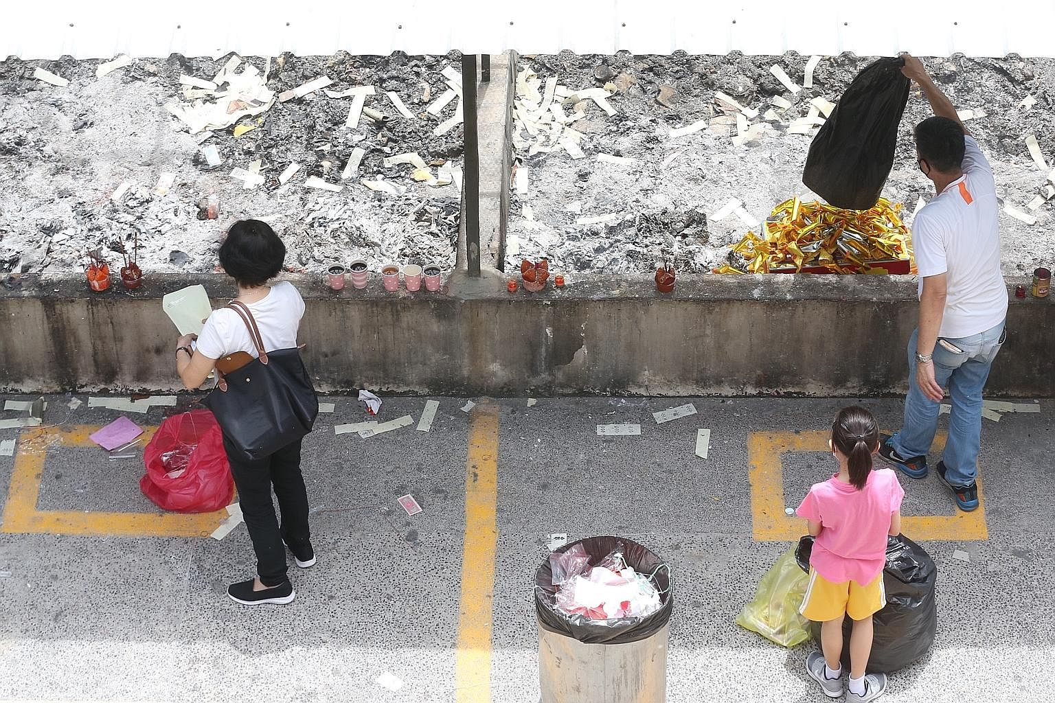 People paying respects to their ancestors at Mandai Columbarium yesterday.
