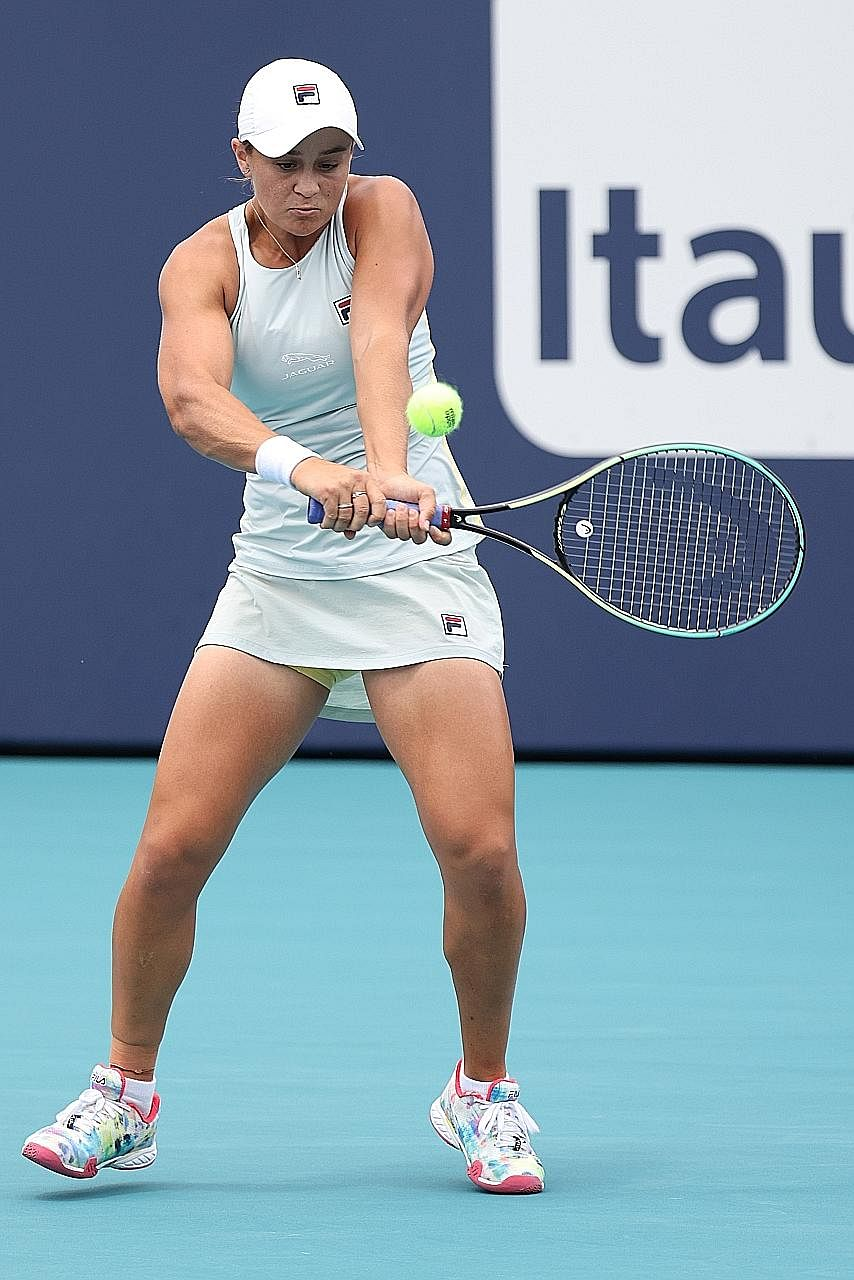 World No. 1 Ashleigh Barty hitting a backhand en route to retaining her Miami Open title. Naomi Osaka has won two of the last three Grand Slams, sparking talk that the Japanese star should be top of the rankings.