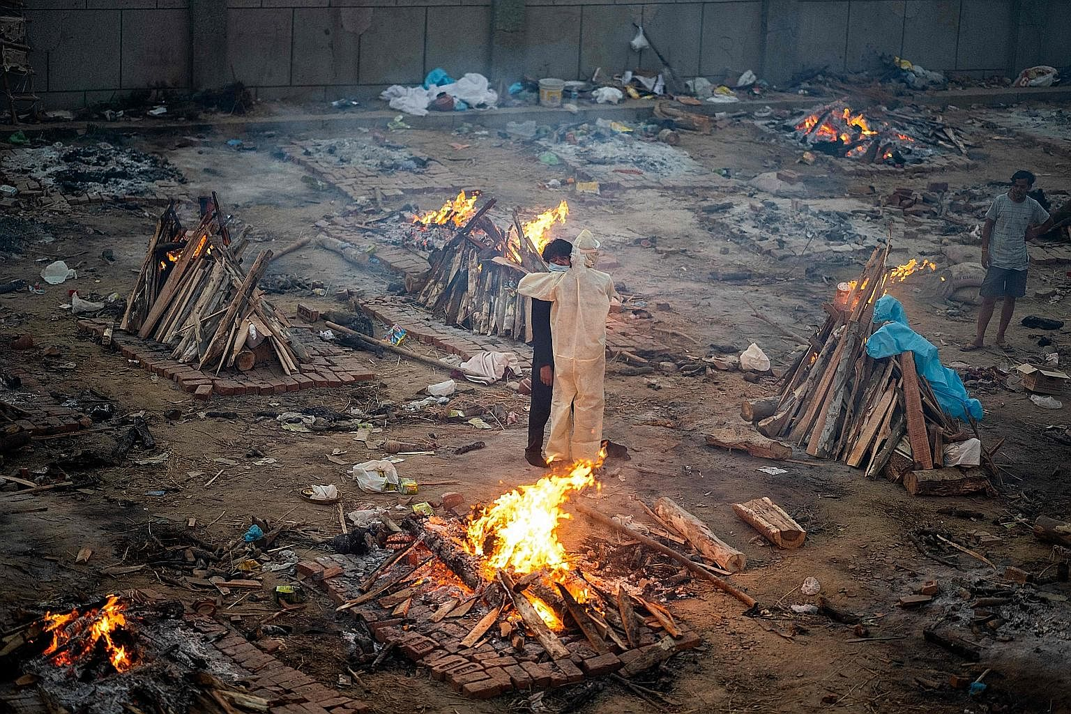 Funeral pyres for those who died from Covid-19 at a cremation ground in New Delhi on Monday. Delhi has been hit by the most severe shortage of oxygen in India.