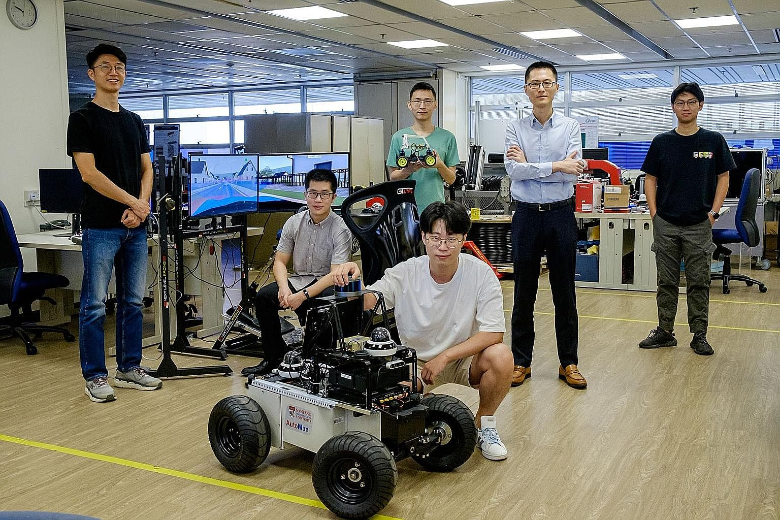 The NTU team comprised Assistant Professor Lyu Chen (second from right) and PhD students Mo Xiaoyu (at far left) and Huang Zhiyu (far right). With them are PhD students (from second left) Zhang Yiran, Wu Jingda (in green), and Huang Wenhui, who are i