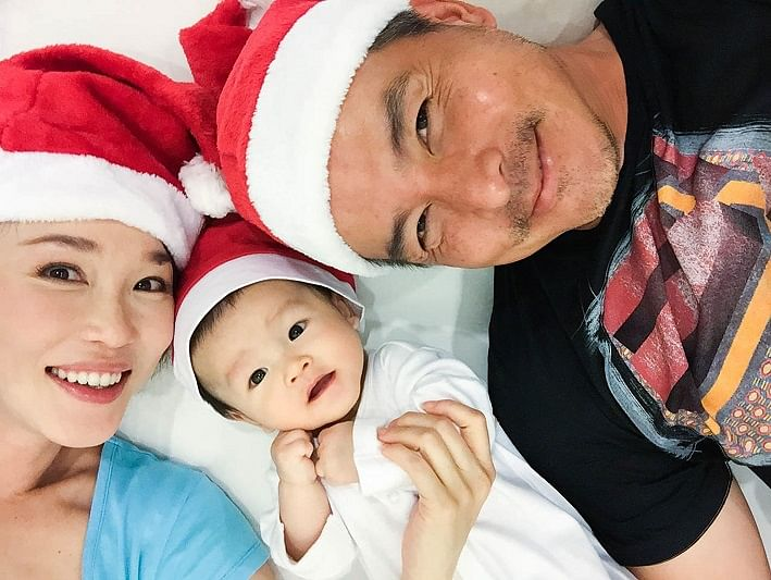 Actress Fann Wong with her husband, actor Christopher Lee, and their baby Zed.
