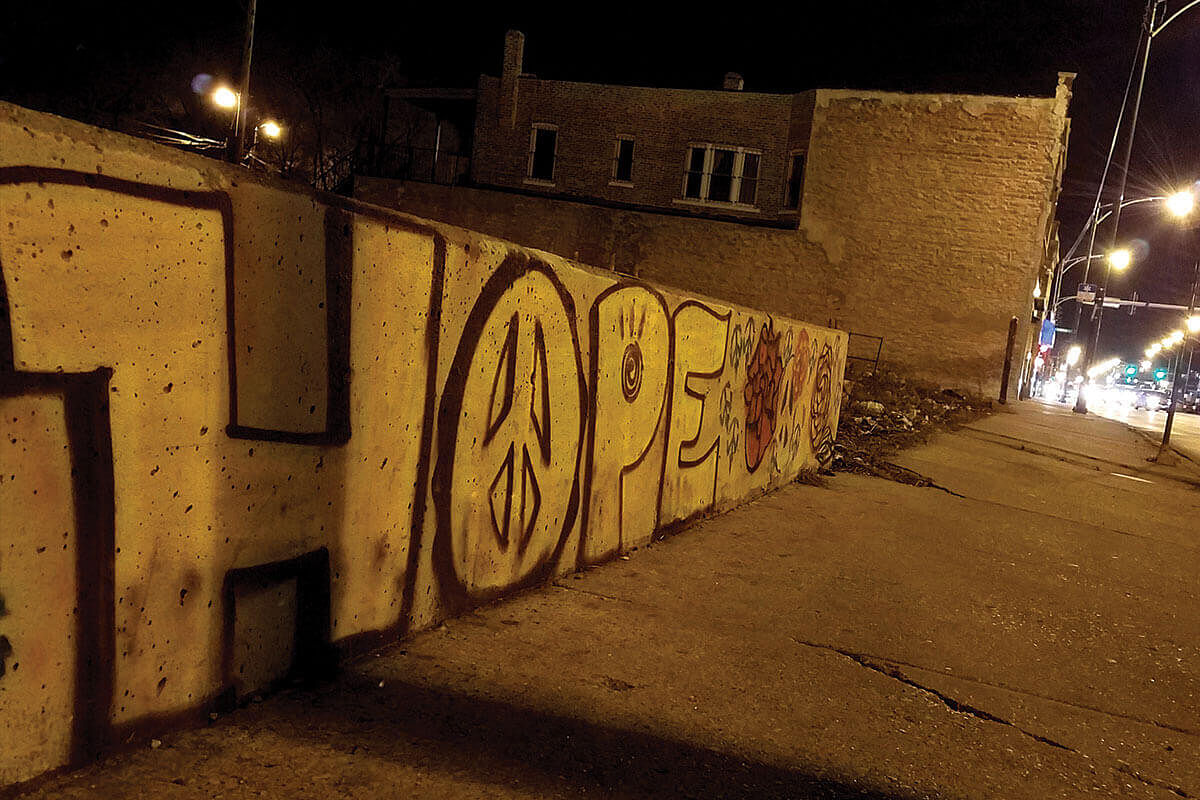The word 'hope' is displayed in graffiti on a wall in South Austin, Chicago.