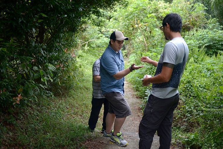 Mr Bjorn Low, co-founder of Edible Gardens, handing some wild edibles picked in Dempsey Hill to Mr Jonathan Lee (with cap), head chef of Artichoke cafe and bar.