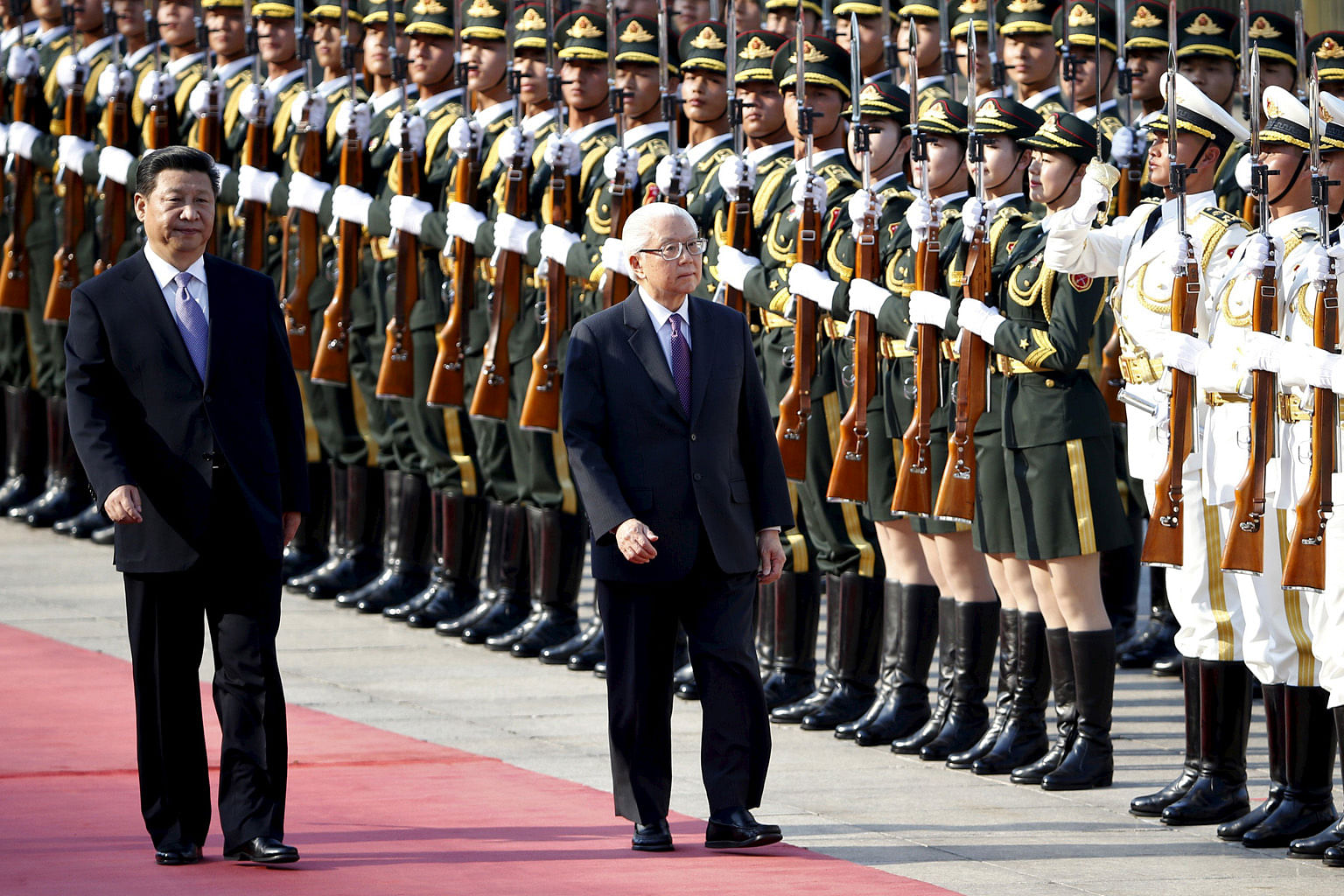 Singapore's President Tony Tan Keng Yam (right) and Chinese President Xi Jinping inspecting honour guards during a welcome ceremony outside the Great Hall of the People in Beijing on July 3.