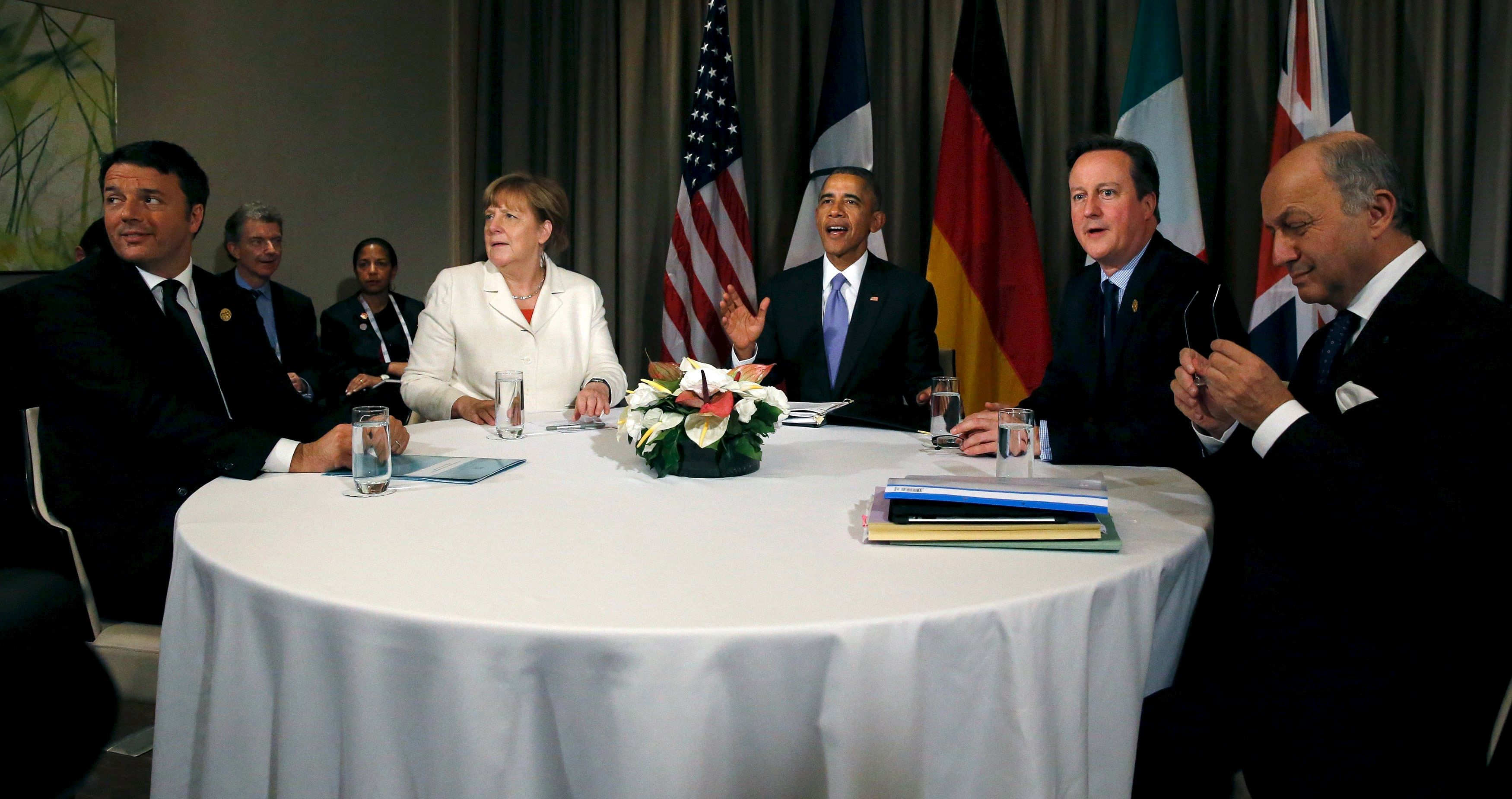 (From left) Italy's Prime Minister Matteo Renzi, Germany's Chancellor Angela Merkel, US President Barack Obama, Britain's Prime Minister David Cameron and France's Foreign Minister Laurent Fabius at a multilateral meeting yesterday.