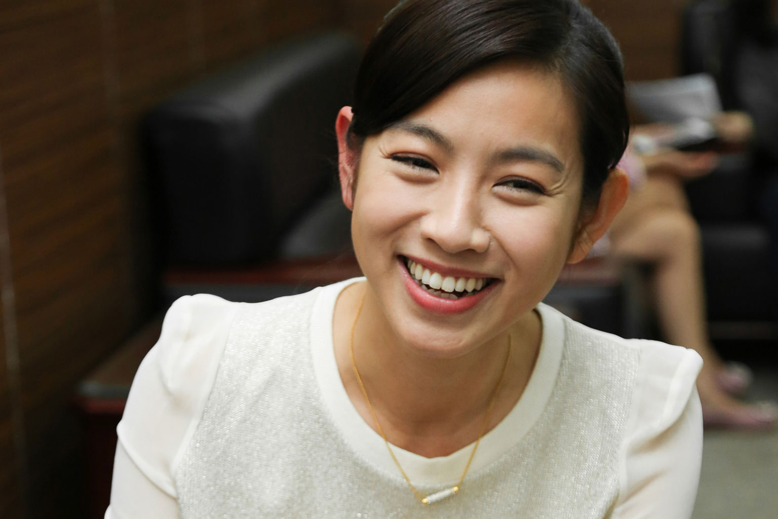 Host-actress Mini Chao (above) says she still has to shave her moustache once a month.
