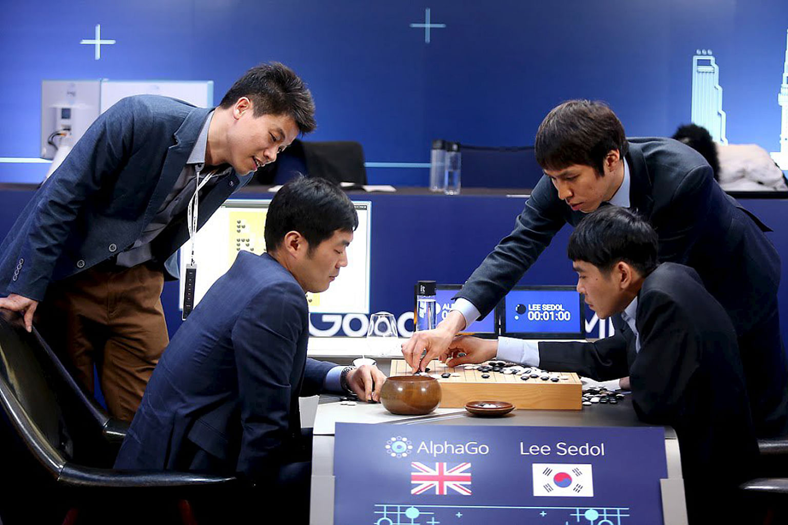 The world's top Go player, Mr Lee Sedol, reviewing his moves after the third match of the Google DeepMind Challenge Match against Google's artificial intelligence program AlphaGo in Seoul in March. The match comprised five games, of which AlphaGo won