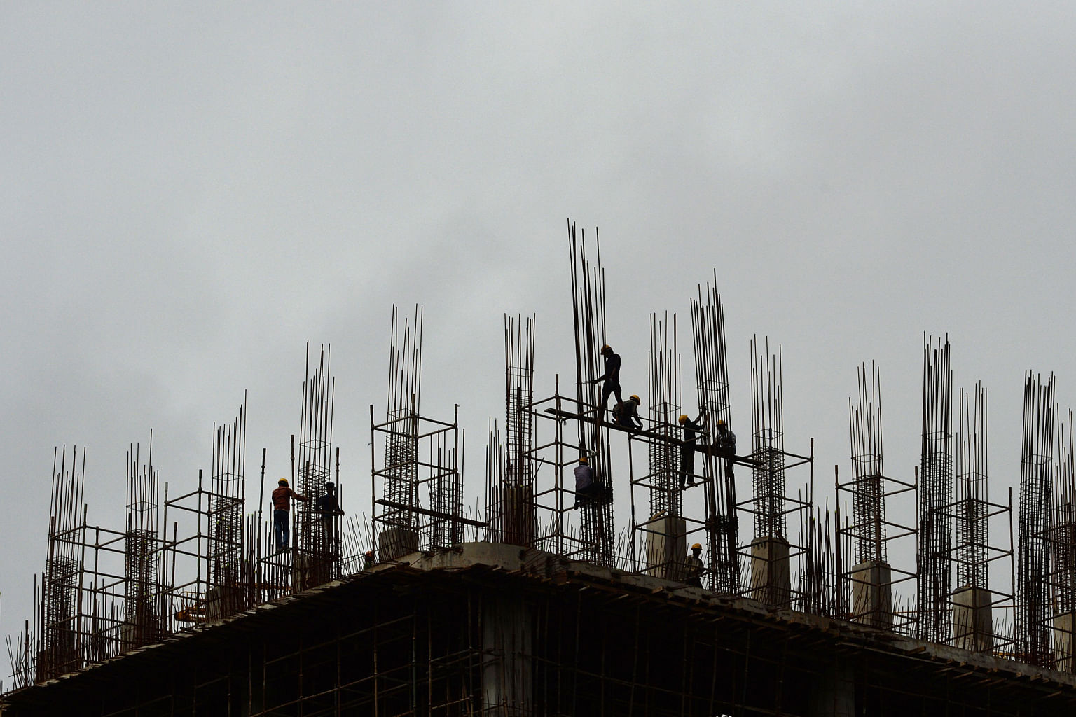 An upcoming high-rise building in the business district of Mumbai. India's economy is growing at a steady clip, with the World Bank forecasting its growth to hit 7.9 per cent by 2018 - making it a bright spot amid the gloomy outlook for developing co