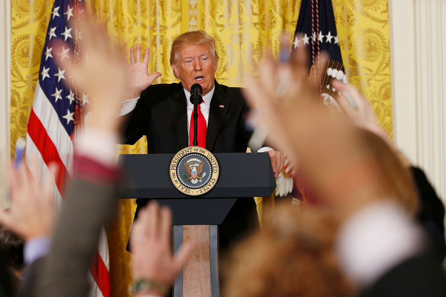 Mr Trump taking questions during a news conference at the White House in Washington last month. The writer says that if the US President gets his way, tariffs on imports could stoke inflation, which in turn could trigger higher US interest rates, tho