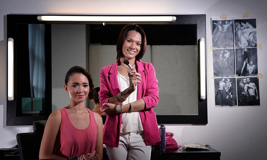 Mr Muhamad Andy Razali (standing), a freelance makeup artist, is featured in 48 Singaporean Seconds, an audio-visual tribute to 20 Singaporeans created by The Straits Times Picture Desk. -- FILE PHOTO: DESMOND LIM