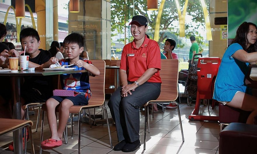 Madam Surina Ismail does not just believe in racial harmony - she practises it.-- ST PHOTO:NEO XIAOBIN