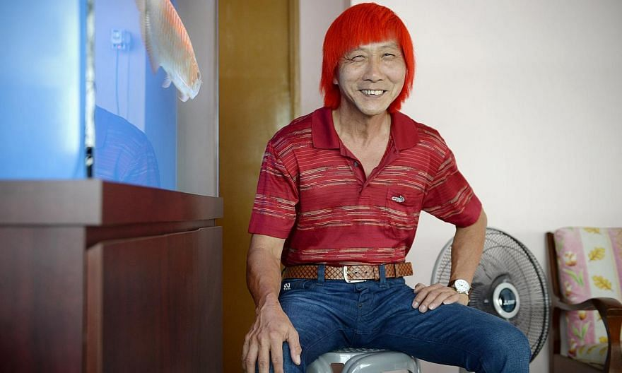 Delivery man Ng Tee Kia stops traffic - with his fiery red hair. -- ST PHOTO: DESMOND LIM
