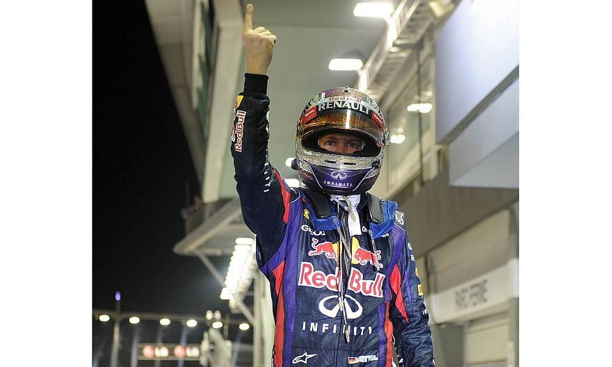 Red Bull driver Sebastian Vettel of Germany gives a thumb-up on the podium after winning the Formula One Singapore Grand Prix on Sept 22, 2013. Formula One supremo Bernie Ecclestone has predicted that triple world champion Vettel's dominance of the s