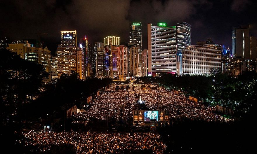 People hold candles to commemorate China's 1989 Tiananmen Square events during a candlelight vigil in Hong Kong on June 4, 2014.China's state censors on Thursday, June 5, 2014, scrubbed the Internet of references to commemorations of the Tianan
