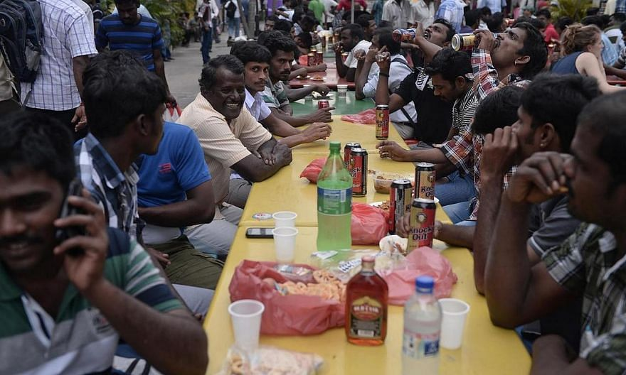 Foreign workers relaxing over liquor at a beer garden in Little India on 22 December 2013.The root cause of the Dec 8 riot in Little India was not foreign workers' systemic dissatisfaction with employment and living conditions here - and prelim
