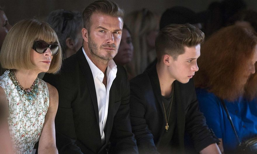 (From left) Vogue editor Anna Wintour, David Beckham and his son Brooklyn Beckham watch a model present a creation during the Victoria Beckham Spring/Summer 2015 collection during New York Fashion Week in the Manhattan borough of New York on Sept 7,