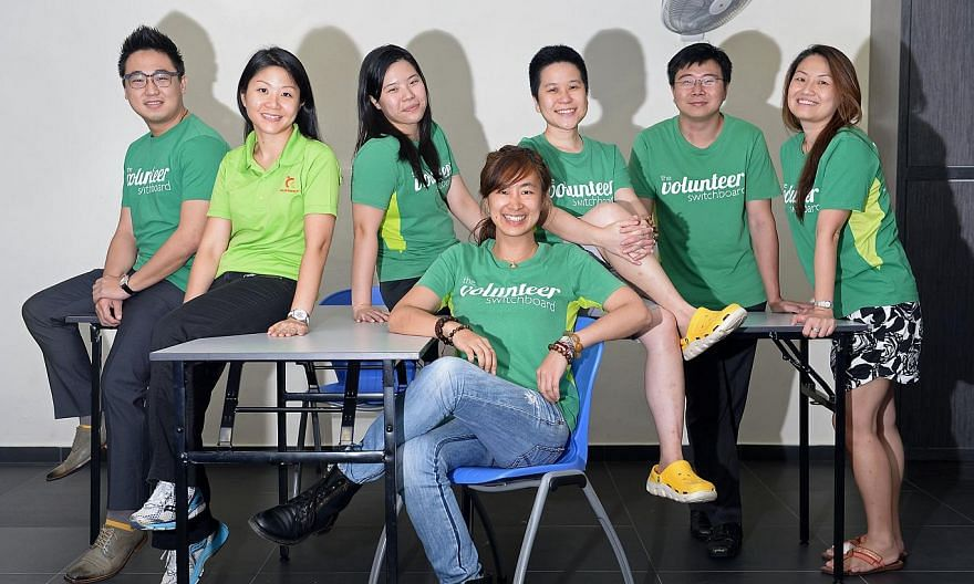 To get help, help others first. A group of volunteers has put a new spin to the usual food distribution programme by getting younger residents to give out rationsto the old before collecting their own. From left: Mr Adrian Goh, 33, Ms Eunice Goh, 34,