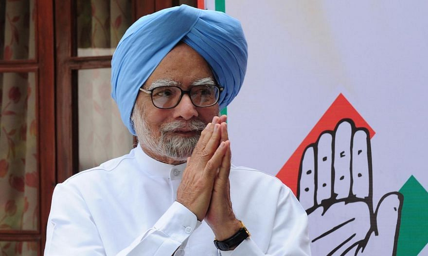 Former Indian PM Manmohan Singh gesturing as he arrives for the launch of an online and application based membership drive of the Congress Party in New Delhi on March 30, 2015.